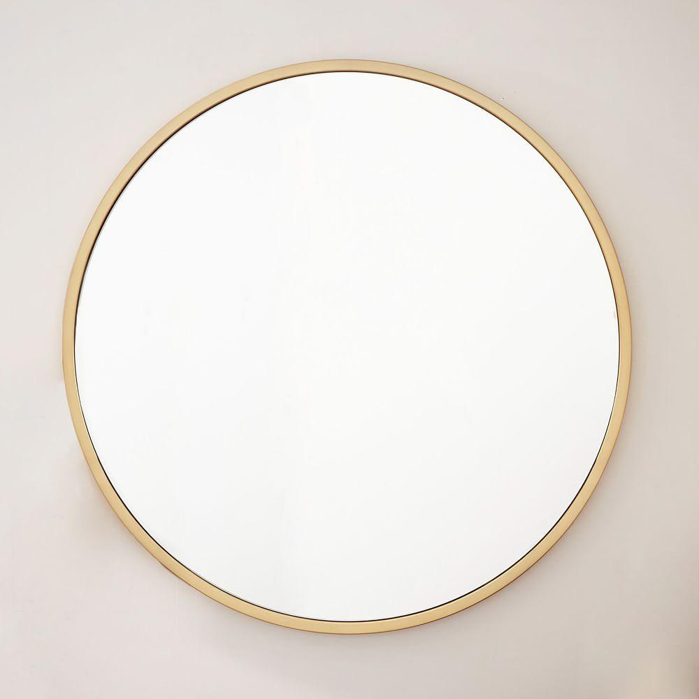 Metal framed oversized round mirror antique brass west for Round mirror