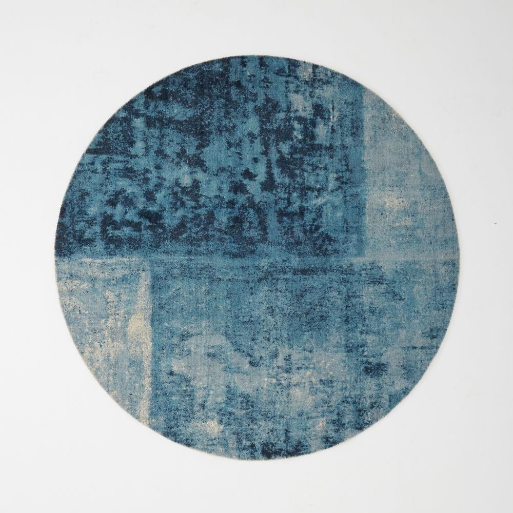 Distressed rococo round wool rug blue lagoon west elm for Round carpets and rugs