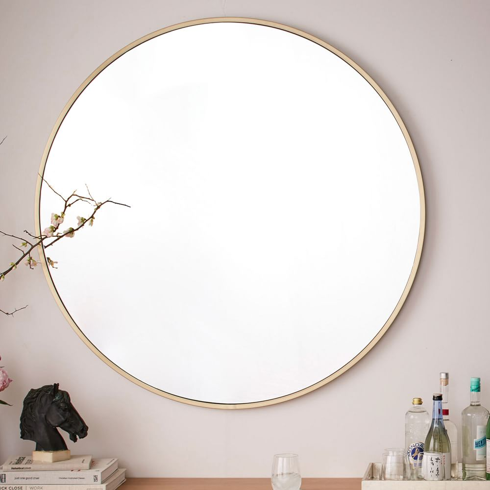 Metal framed oversized round mirror antique brass west Round framed mirror