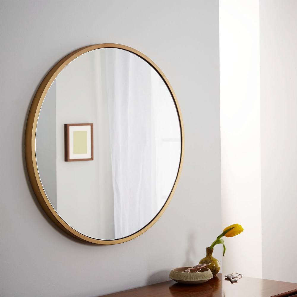 metal framed round wall mirror antique brass